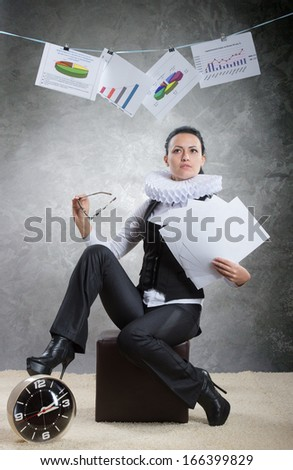Queen of office. Business lady in ruff collar finishing a project successfully - stock photo