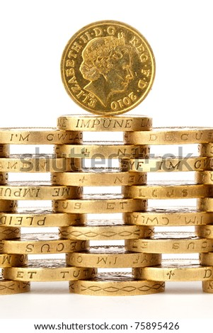 queen's head on british one pound coins - stock photo