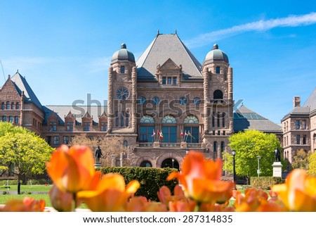 Queen's Park building and tulip gardens, the landmark is the seat of the Ontario Provincial Government. - stock photo