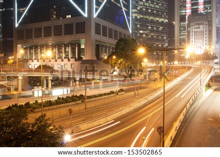 Queen's Road Central winding its way through the central business district of Hong Kong - stock photo