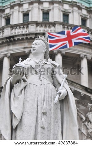 Queen Victoria Statue with Union Flag Behind - stock photo