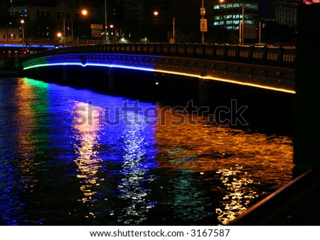 Queens bridge and Yarra river at night (Melbourne, Australia)