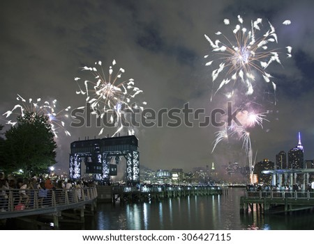 QUEENS, NEW YORK - JULY 4: Macy's independence day firework celebration in NYC as viewed from Gantry Plaza State Park in Long Island City.   Taken July 4, 2015 in Queens, NY. - stock photo
