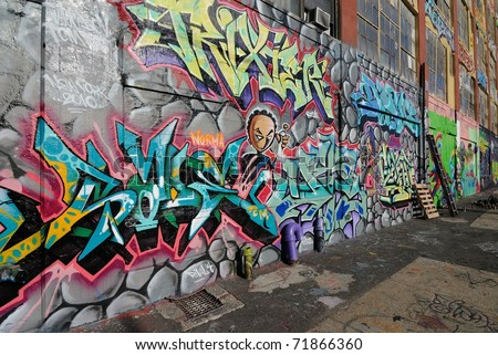 QUEENS, NEW YORK - OCTOBER 7: Five Pointz, considered a graffiti mecca, is an outdoor exhibit space featuring numerous graffiti artists October 7, 2010 in Queens, New York. - stock photo