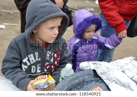 QUEENS, NY - NOVEMBER 11: Hungry kids getting help with hot food and supplies in the Rockaway beach area due to impact from Hurricane Sandy in Queens, New York, U.S., on November 11, 2012. - stock photo