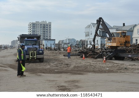 QUEENS, NY - NOVEMBER 11: U.S. Navy working on the streets ater massive destruction in the Rockaway Beach area due to impact from Hurricane Sandy in Queens, New York, U.S., on November 11, 2012. - stock photo