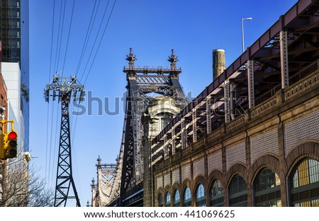 Queensboro Bridge, Manhattan Side, and Roosevelt Island Tramway Mast, New York - stock photo