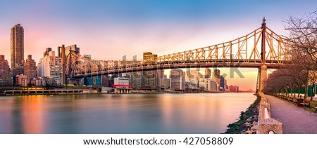 Queensboro bridge panorama at sunset, as viewed from Roosevelt Island - stock photo