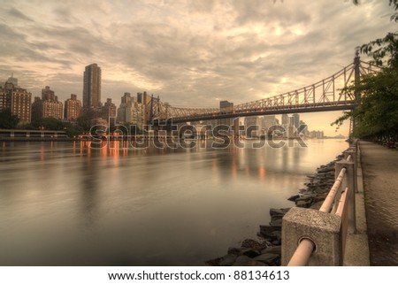 Queensboro Bridge Spanning the East River in New York City on a cloudy morning. - stock photo