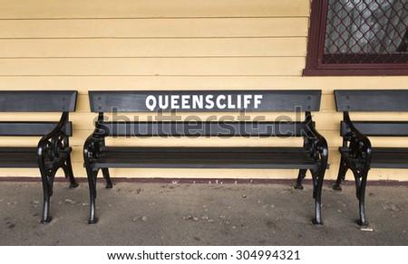 QUEENSCLIFF, VICTORIA, AUSTRALIA - May 6, 2015: Passenger bench at the Queenscliff Railway Station (c1879), the only timber railway station in Victoria, Australia. - stock photo