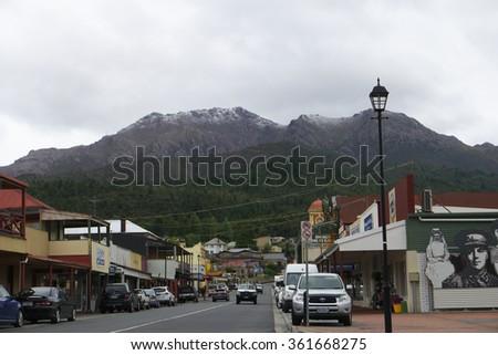 QUEENSTOWN, AUSTRALIA - NOVEMBER 26 : Street scene  during climate change weather event of unseasonal snow in summer accross Tasmania  November 26, 2015 in Queenstown, Australia - stock photo