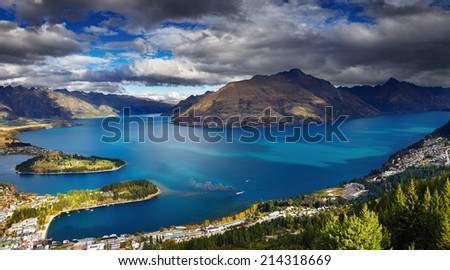 Queenstown cityscape with Wakatipu lake and Remarkables Mountains, New Zealand - stock photo