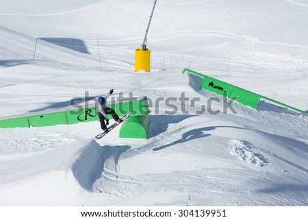 QUEENSTOWN, NEW ZEALAND - AUGUST 6: Unidentified Snowboarder jumps in Snow Park on the Remarkables Ski Area on August 6 2015 in Queenstown, South Island, New Zealand - stock photo
