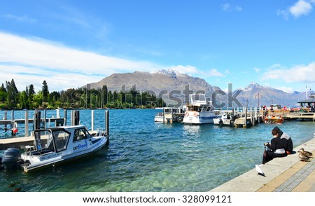 QUEENSTOWN, NEW ZEALAND - Nov18: Ferries waiting at jetty of Lake Wakatipu, Queenstown, South Island New Zealand. Taken on Nov18, 2015 - stock photo