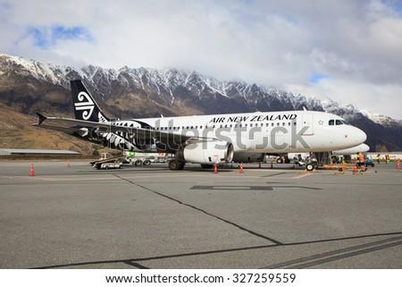 QUEENSTOWN NEW ZEALAND - SEPTEMBER 6: air new zealand plane preparing to flight at queenstown airport in south island new zealand on september 6, 2015 in Queenstown New Zealand - stock photo
