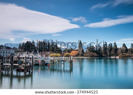 QUEENSTOWN, NEW ZEALAND - September 8: Lake Wakatipu and The Remarkables in Spring - 8 September, 2015. Queenstown is the Southern Hemisphere's premier four season lake and alpine resort. - stock photo