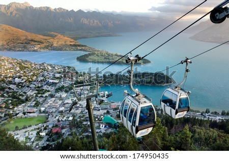 QUEENSTOWN, NZ - JAN 17:Queenstown Skyline Gondola during sunset on Jan 17 2014.It's the steepest cable car lift in the Southern Hemisphere, and one of the must-do activities in Queenstown, NZ. - stock photo