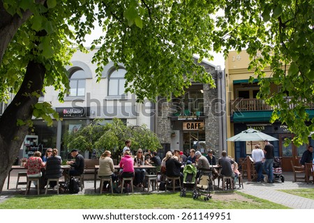 QUEENSTOWN, NZ - NOV 23 : Cafe in Queenstown city center on Nov 23, 2014. Crowded area full with tourists during lunch time in Queenstown, NZ. - stock photo