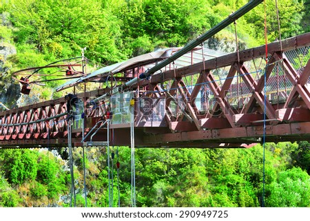 QUEENSTOWN, NZ - Nov 20:Person during bungy jump on November 20 2014. Bungy New Zealand's Kawarau Bridge bungy site (established 1988) was the first commercial bungy operation in the world. - stock photo