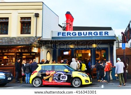 QUEENSTOWN, NZ - Nov18: Visitors at Fergburger in Queenstown Mall on Nov18 2014.It's one of the most popular travel destination in New Zealand known for it's restaurants,and extreme sport adventure. - stock photo