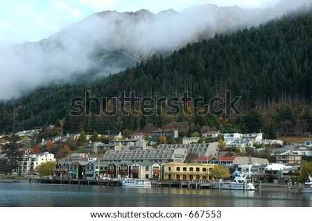 Queenstown town with a mountain as backdrop - stock photo
