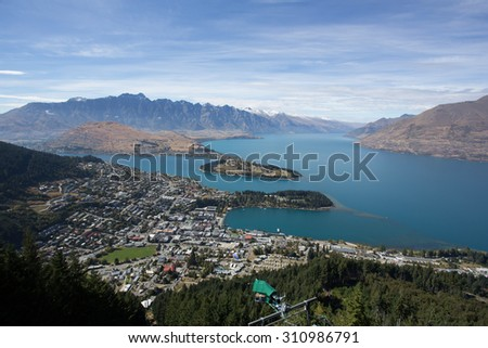 Queenstown with the Remarkables in the backround - stock photo