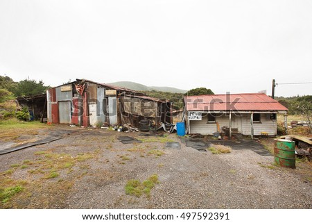 Queenstwon, Australia-March 5, 2012. Rundown and ramshackle home and sheds on a property on the outskirts of the west coast township of Queenstown, Tasmania, Australia