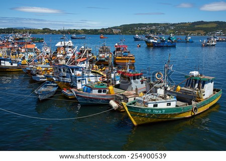 QUELLON, CHILE - JANUARY 15, 2015: Colourful fishing boats in the coastal town of Quellon on the island of Chiloe in Chile