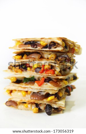 quesadilla stacked on white vertical - stock photo
