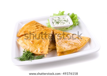 Quesadillas on whte plate with sauce - stock photo