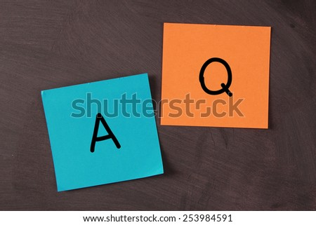 Question and Answer notes pasted on blackboard. - stock photo