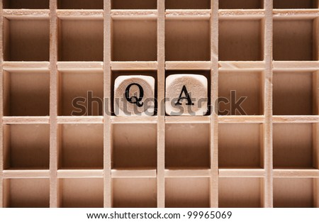 Question and answer or Q & A letter cubes with a shallow depth of field