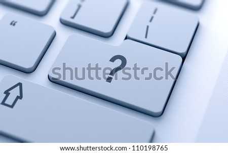 Question button on keyboard with soft focus - stock photo