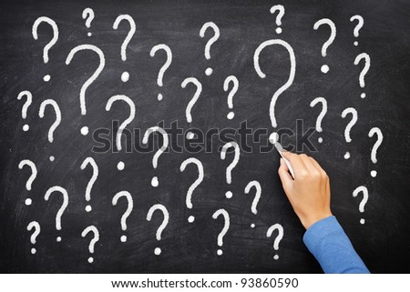 Question mark blackboard sign. Question marks on chalkboard. Decision, confusion, FAQ or other concept. Hand writing with chalk on school black board. - stock photo