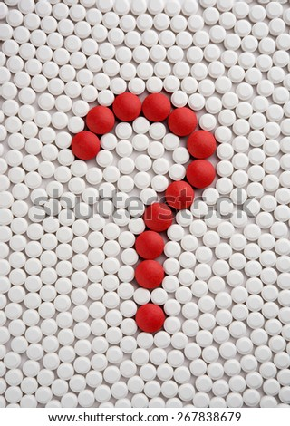 Question mark formed by various pills - stock photo