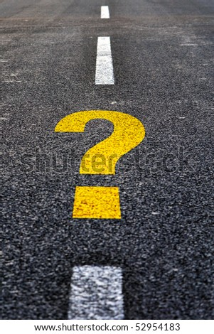 Question mark on asphalt road. Travel to unknown destination concept. - stock photo