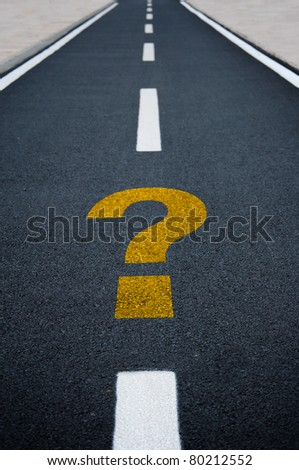 Question mark on asphalt road. Travel to unknown destination concept.