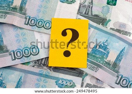 Question mark on russian ruble banknotes. - stock photo