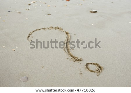 Question mark on the beach. - stock photo