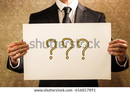 Question Mark text with businessman holding a sign board