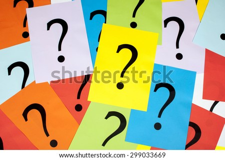 question marks on sheet of paper - stock photo