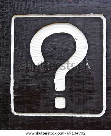 question sign on black wood - stock photo