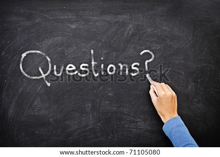 Question written on chalkboard / blackboard. Hand writing with chalk - great texture. - stock photo