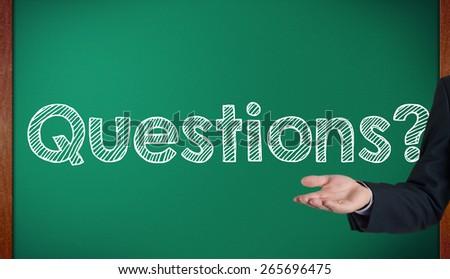 Question written on chalkboard / blackboard presenting by hand - stock photo