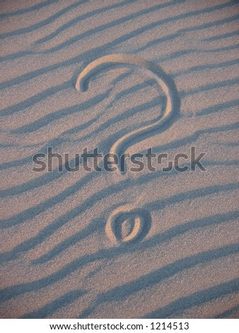 Questionmark in sand - stock photo