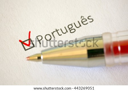 Questionnaire. Red pen and the inscription PORTUGUESE with check mark on the white paper