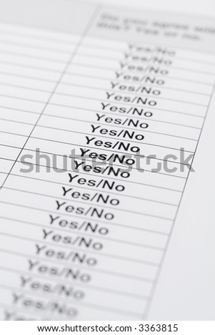 Questionnaire sheet of paper with a column yes/no. Focus on one line in the middle. - stock photo