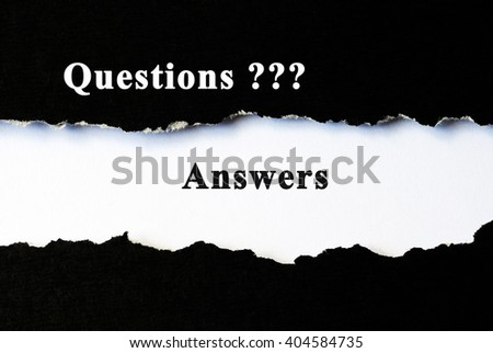 Questions and answers concept word under torn paper - stock photo