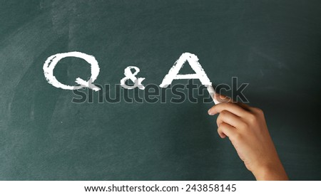 Questions and Answers - Q and A Concept on Blackboard - stock photo