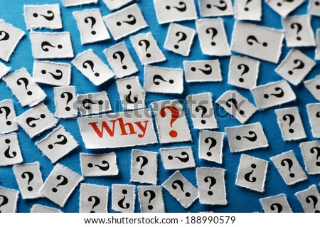 questions why on cut paper on blue background close up - stock photo